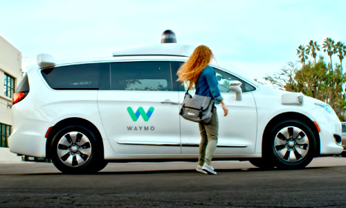 passenger entering Waymo self-driving vehicle